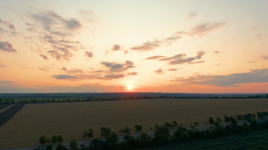 lowland : Aerial view. Beautiful nature, view on rural countryside landscape and fields, shining sun sunset, sky, horizon.