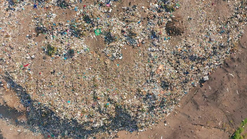 bolsa : Aerial view. Garbage pile in trash dump. Environmental pollution from consumerism household. Stock Footage