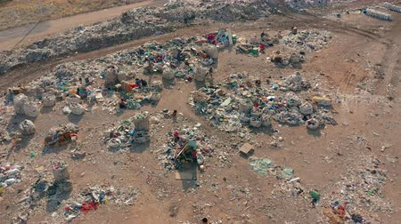 dumping : Aerial View. City Dump concept. Environmental pollution. Plastic bottles, bags, trash. Nature polluted from activities of irresponsible people.