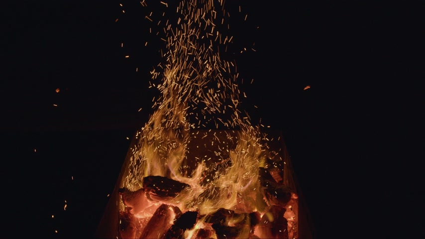 ember : Coal. The charcoal is burning up in the kebab barbecue. The fire is burning. Fire for barbecue. Barbecue fire.