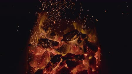 ember : Close-up of burning black coals. Action. Burning out small flames on coals for barbecue in nature. Hot burning coals.