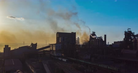 emissions : Aerial view. Timelapse. Smoke from the factory pipes. Ecology is under threat.