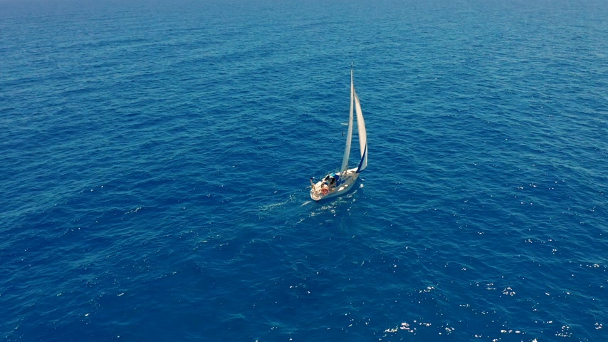 denizciler : Aerial view. Yacht sailing on open sea at sunny day. Sailing boat in sea. Stok Video