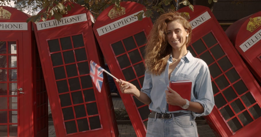 geográfico : The woman holding British flag and book, education abroad, learning language.