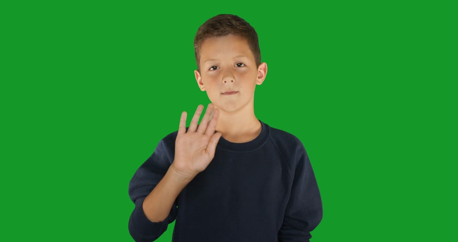 pięśc : Deaf boy signing I know sign language, communication for hearing impaired. Green screen