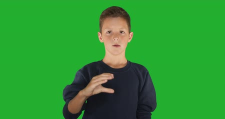 немой : Deaf boy signing I know sign language, communication for hearing impaired. Green screen