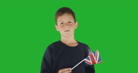hromakey : Portrait of boy with flag of great britain. Green screen hromakey background for keying. Stock Footage