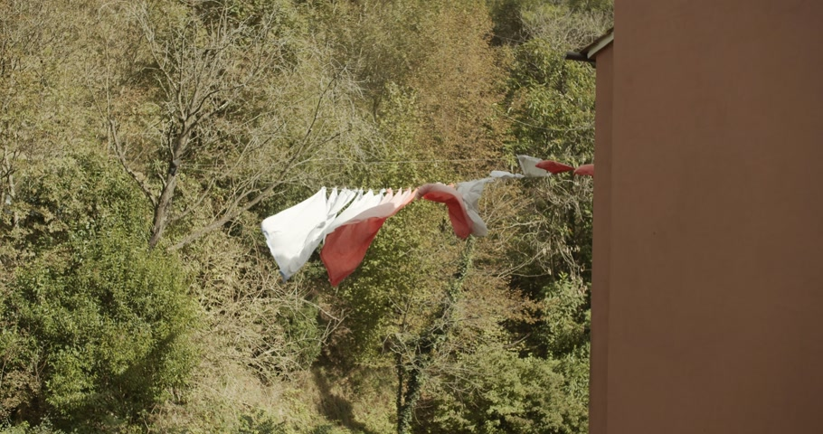 szárítókötél : Clothes is dried on a clothesline on outdoor slow motion. Stock mozgókép