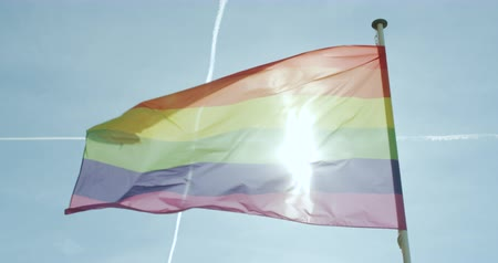 election campaign : Big Rainbow flag gay pride LGBTQ blowing in the wind.