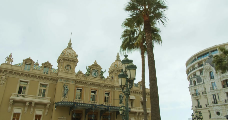 отель : Monte-Carlo, Monaco - October 15, 2019: Grand Casino in Monte Carlo timelapse, Monaco. historical building. Front view with entrance.