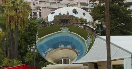 zegar : Monte-Carlo, Monaco - October 15, 2019: Mirror reflection of Grand Theatre building in Monte Carlo.