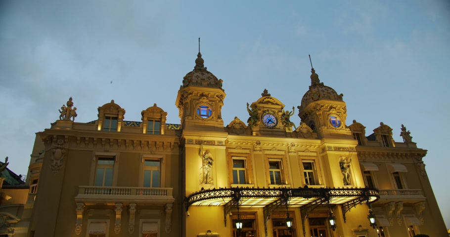 Monte-Carlo, Monaco - October 15, 2019: Grand Casino in Monte Carlo night Monaco, historical building. Front view with entrance.Evening illumination. Stok Video