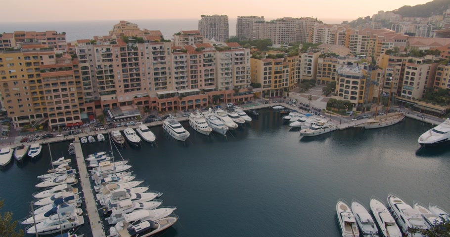 príncipe : Yahts marina in Monaco, Monte Carlo town. Yacht and sailboats moored at the quay. Top view harbor. Stock Footage