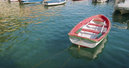 alpes : Red boat anchored at the sea port.A small fishing boat. Italy.