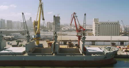 CASABLANCA, MOROCCO - October 15, 2019: Loading a cargo ship at the seaport. Port with large ships and cranes, timelapse.