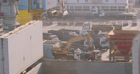 CASABLANCA, MOROCCO - October 15, 2019: Port crane lifts an excavator. Cranes Loading And Unloading Cargo From Ship At Port. Stok Video