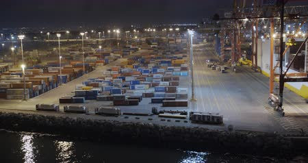 ithalat : Aeial view. Container Terminals. Night time illuminated port aerial panorama.