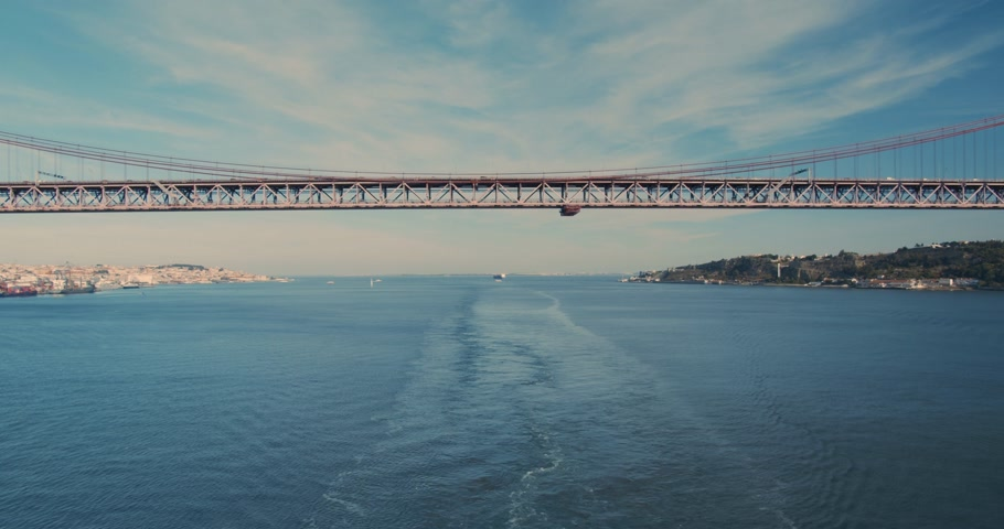 europa : Aerial view. suspension bridge over Tagus river in Lisbon. 25th april bridge symbol of Portugal in sun shining. Timelapse. Wideo