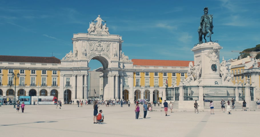 Lisbon, Portugal - October 15, 2019: Commercial square city centre, people are walking summer, sun bright vacations, Lisbon Portugal. Timelaspe. Stok Video