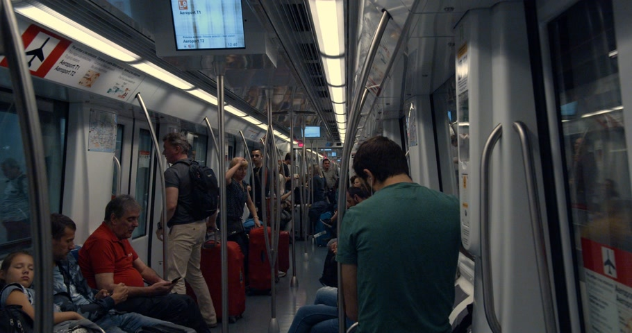 Barcelona, Spain - October 15, 2019: People go in modern Underground metro in a big city Megalopolis.