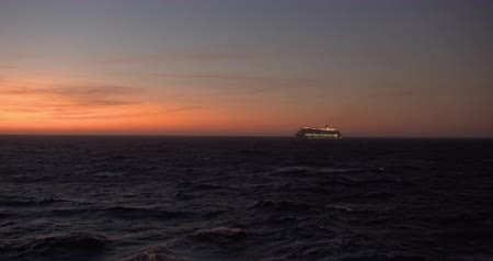 relaks : Luxury cruise ship on the pink sunset light.