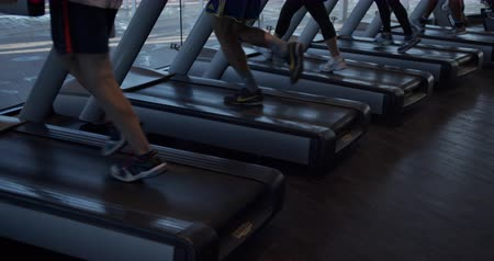 Barcelona, Spain - October 20, 2019: Group running on a treadmill at gym. Fitness and healthy lifestyle concept.