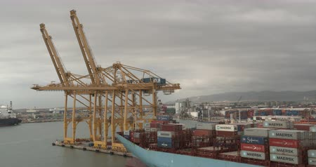 Barcelona, Spain - October 20, 2019: Aerial view. Seaport and loading docks at the port with cranes and multi-colored cargo containers. Stok Video