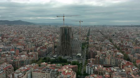 архитектурный : Barcelona, Spain - November 25, 2019: Sagrada Familia cathedral and Barcelona city aerial view in Spain.