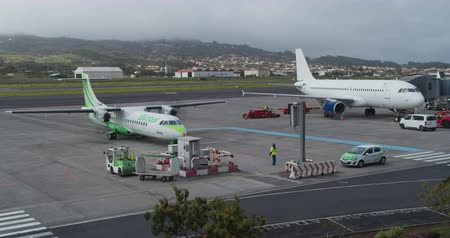 FEBRUARY 15th, 2020 - TENERIFE, CANARY ISLANDS, SPAIN: Timelapse of the on-site handling of an airplane at the airport. Airport service.