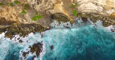 dron : Aerial of beautiful cliffs and waves. Above the sea drone footage. Uluwatu, Bali Wideo