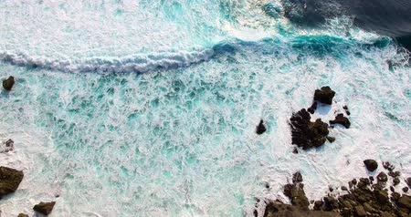Aerial footage of incredible ocean waves. Drone view how waves crashing on shore