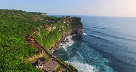 Uluwatu cliff aerial footage, Bali, Indonesia. Camera moves along the cliff