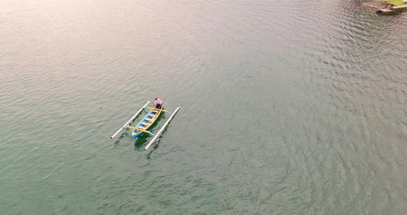 Aerial view above fisher. Fishing boat with man in the lake Stock Footage