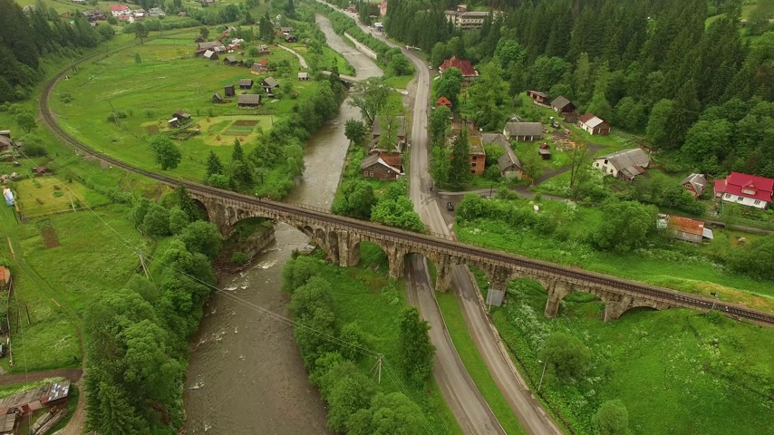 Aerial drone view old bridge under river and road. Flying footage mountain forest Stock Footage