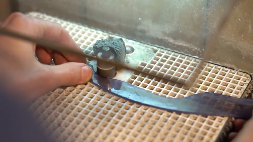 Grinding piece of glass on grinder machine for making stained glass Stock Footage
