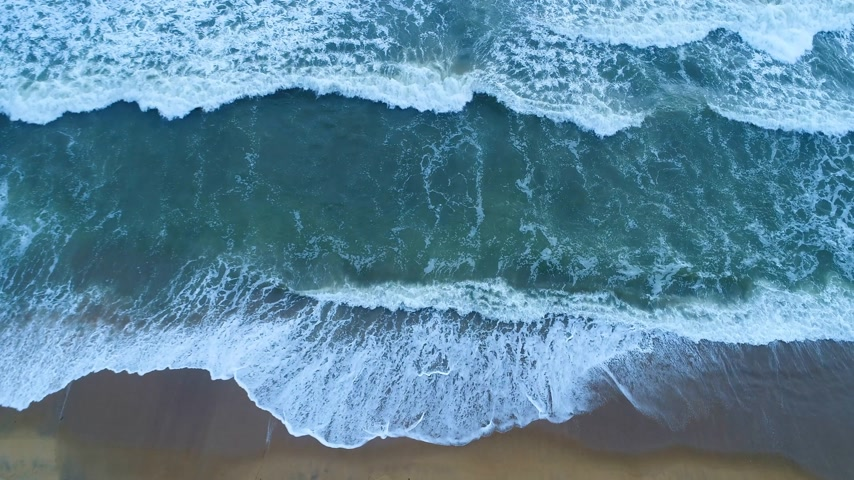 Aerial of the sandy beach that is washed by turquoise sea waves in Sri Lanka Stock Footage