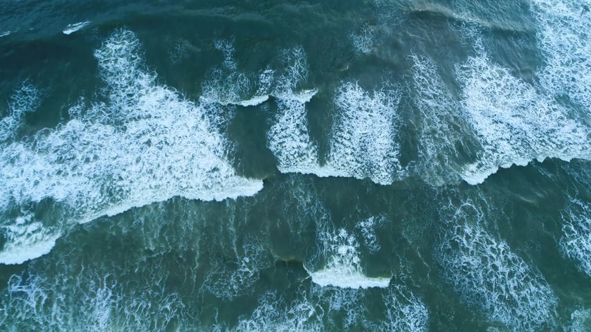 Aerial top shot of the sandy beach that is washed by light waves in Sri Lanka Stock Footage