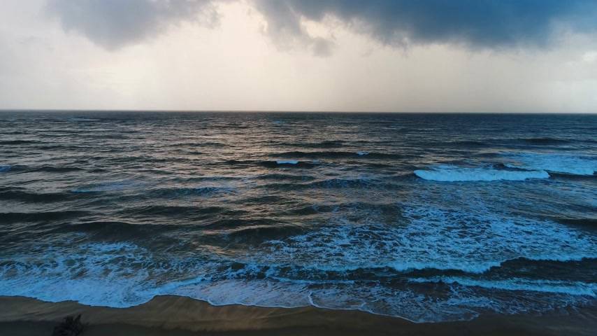 Aerial of sea leaving in the horizon under the cloudy sky in Sri Lanka Stock Footage