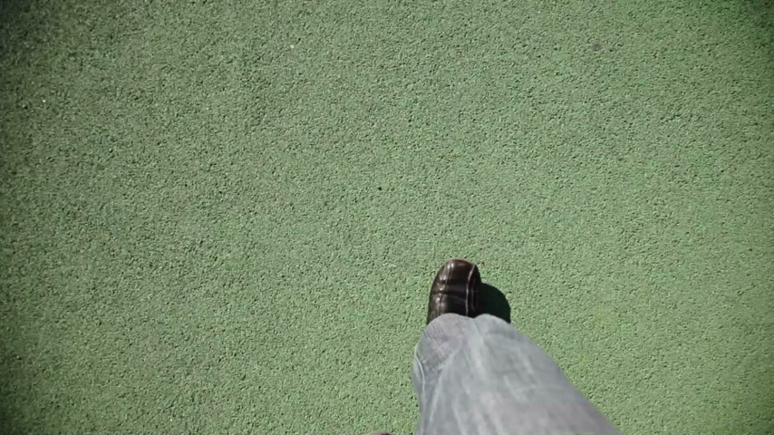 point of view pov : Man Walking on green texture Stock Footage