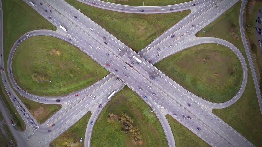 eye : Aerial Footage of Highway and Overpass with cars and trucks Non Moving Aerial Footage of Highway and Overpass Urban Life with cars and trucks modern