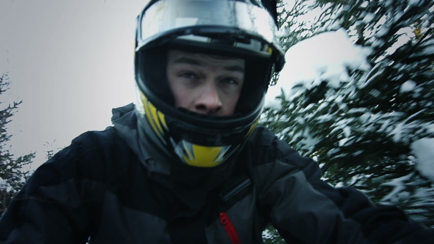 kask : Snowmobile Drivers Face Closeup Riding in the Forest
