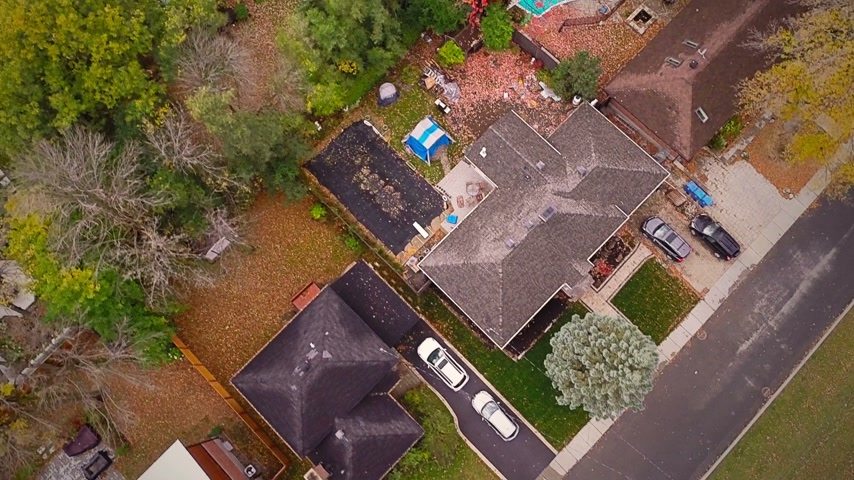 drone : Top Suburban View of Montreal and beautiful Trees during a Cloudy Autumn day