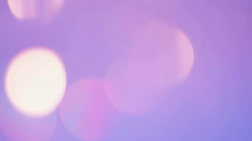 diamantes : Beautiful Chandelier with Pink and Purple Light getting in Focus