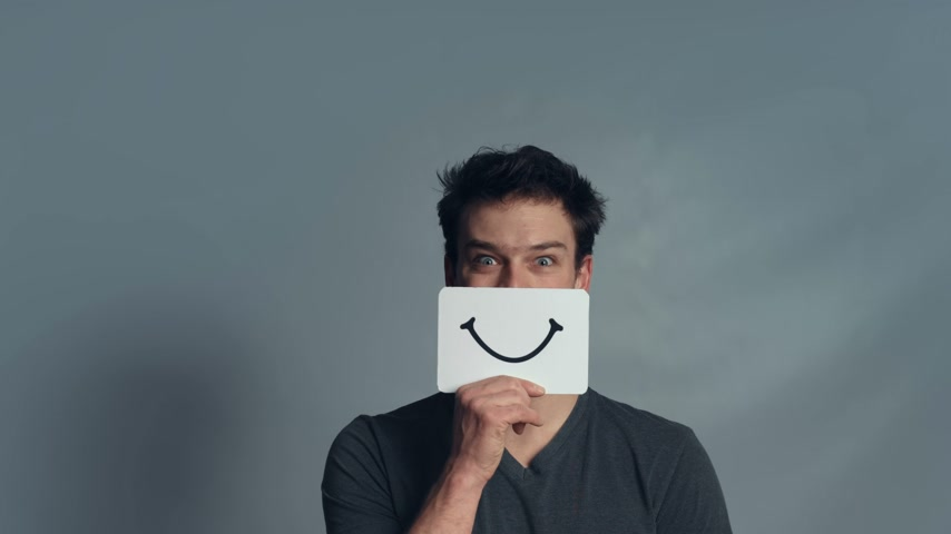emoticon : Man showing his Emotions Using A piece of Cardboard