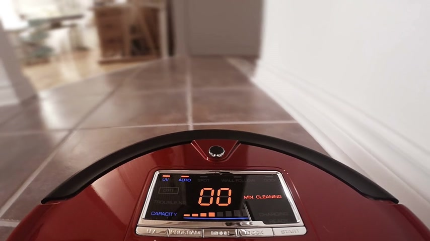 cleaner : Automatic Vacuum Robot Cleaning the House Floor Itself. Camera mounted directly on the Sweeper.