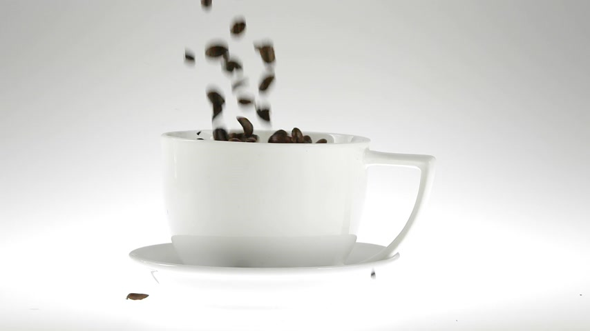 render : 180fps Super Slow Motion Coffee Seeds Falling into White Cup