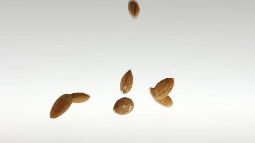 180fps Super Slow Motion Almonds Falling on White Surface Stock Footage