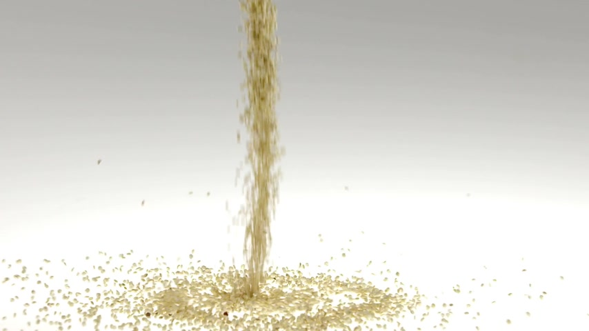 światłowód : 180fps Super Slow Motion Quinoa Seeds Falling on White Surface