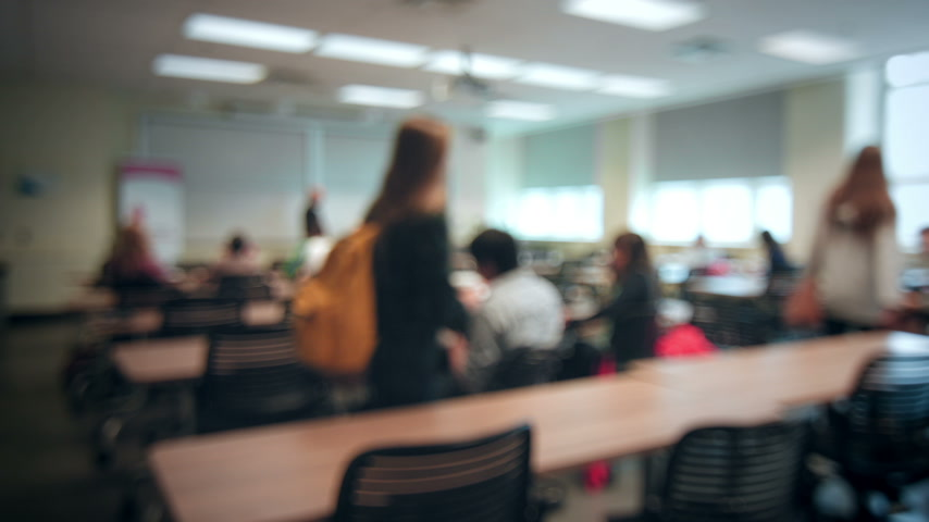 aluno : Back to School concept with Students Entering into a Blurred Classroom