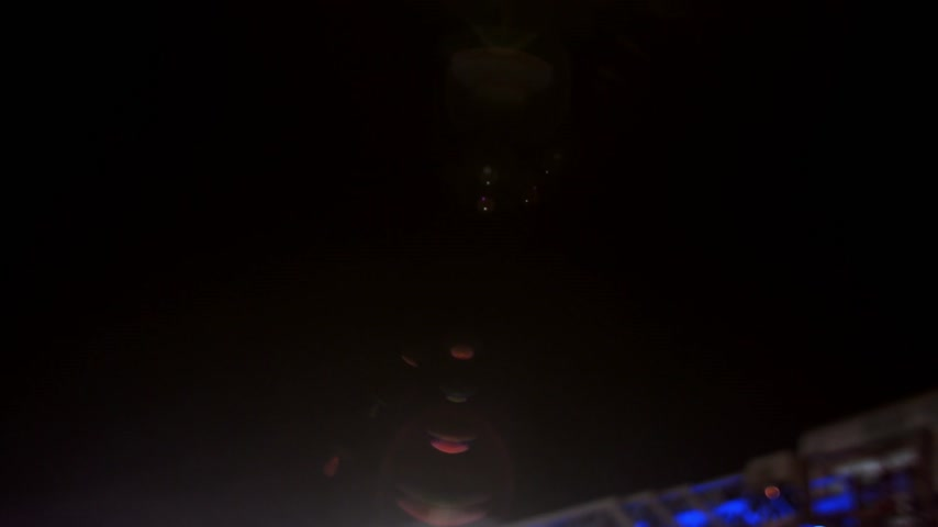 trabalho : Firetruck and Fireman walking around it at Night. Unrecognizable People of Blurry details.